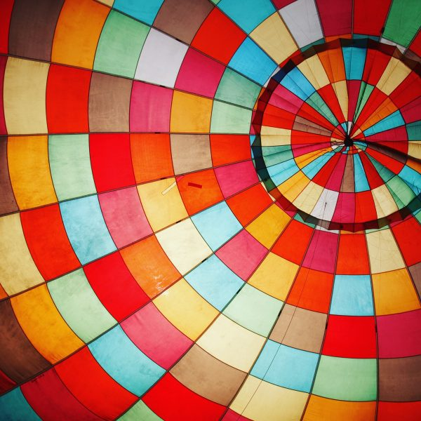 Looking inside a hot air balloon as it is inflated before take-off.